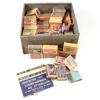 Lot 91-Advertising: A collection of vintage matchboxes in an old cake tin.