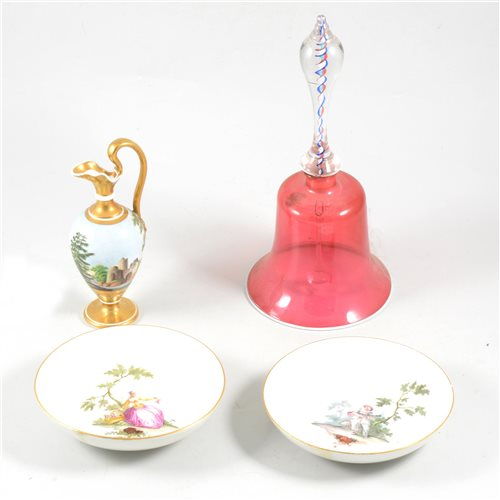 Lot 10-Pair of Meissen saucers, painted with pierrot and a lady gardener, diameter 14cm, an Italian style porcelain ewer and cranberry glass table bell, (4).