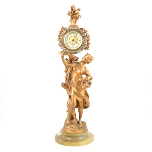 Lot 88-A French style figural clock with paste bezel to dial.