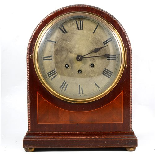 Lot 85-A mahogany mantel clock, domed top, strike and Westminster chime on a gong.