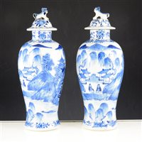 Lot 1-Pair of Chinese blue and white porcelain covered vases, bearing four character marks, of baluster shape, painted with landscape scenes, 29cm.