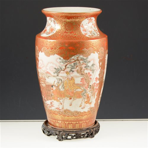 Lot 38-Satsuma vase, probably Meiji, of shouldered form, panelled decoration with figures, landscapes, birds and flowers, fourteen character inscription to the base, 35cm, on a wooden stand.