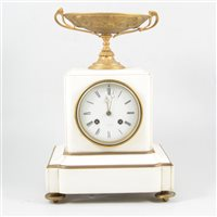 Lot 92-A white marble and gilt metal mantel clock, signed Charles Oudin, Palais Royal, Paris.