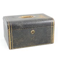 Lot 90-A gilt-tooled leather jewellery box, late 19th/ early 20th Century.