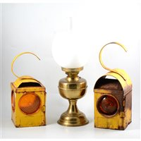 Lot 134-Three yellow enamelled Chalwyn road lamps and a brass oil lamp (4).