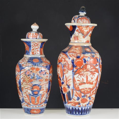 Lot 33-A quantity of Imari wares, including two covered vases, plates and a charger.
