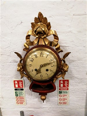 Lot 204-Swedish stained wood and gilt gesso Cartel clock, ...