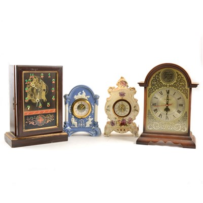 Lot 191-Stained wood shelf clock, lacking original dial, ...
