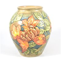 "Lot 8-Philip Gibson for Moorcroft, a ""Flame of the Forest"" design vase."