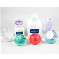 Lot 11-A collection of six Caithness glass paperweights and a vase.