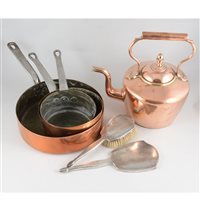 Lot 125-Two copper kettles, oval 23cm, round 32cm, horse brasses, a set of three copper saucepans diameter 15cm, 18cm and 25cm, 8cm deep, two Sam Brown leather belts, three piece silver brush/mirror set