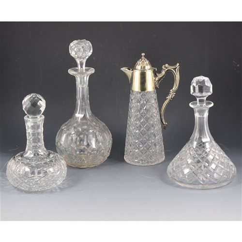 Lot 41-Moulded glass claret jug, electroplate mounts, and various decanters.
