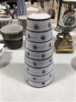 Lot 15-A quantity of Rye pottery, including a conical shaped lamp base, vertical purple stripes with black stars and orange circles, 22cm, another with blue horizontal stripes, stars and circles, 21cm. (13)