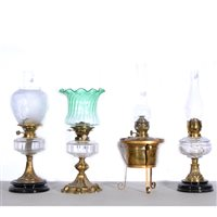 Lot 168-Four oil lamps, to include Hink's No. 2, green wrythen fluted shade, clear transparent reservoir, brass column and base in hexagonal-style shape, no chimney, 46cm... (4)