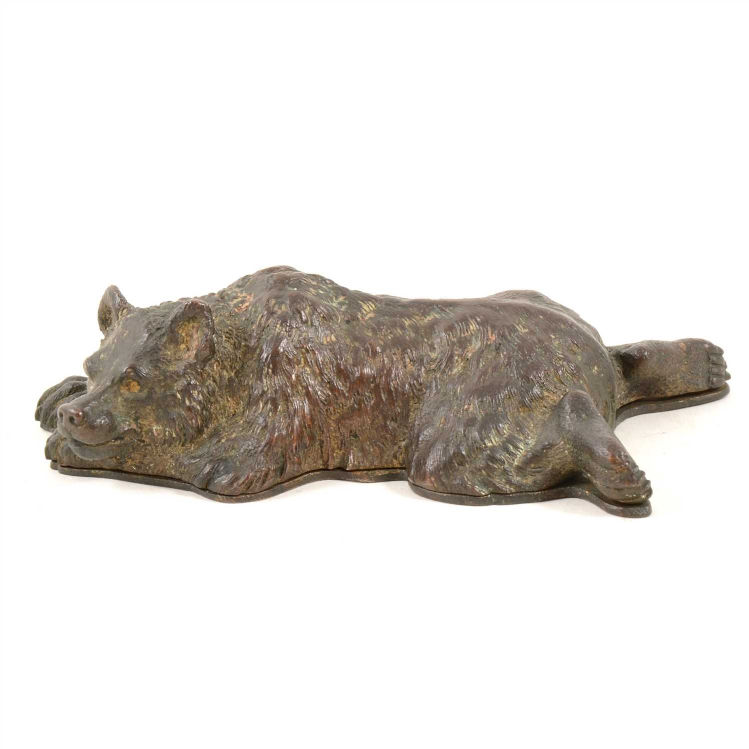 Lot 152-Bronzed and gilt metal novelty desk-top stamp box, designed as a sleeping bear, length 15cm.