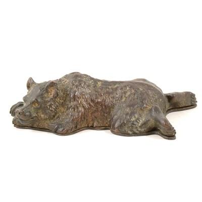 Lot 152-Bronzed and gilt metal novelty desk-top stamp box, designed as a sleeping bear, length 15cm.