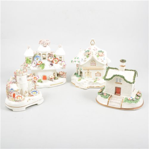 Lot 73-A collection of eleven Staffordshire pottery cottages and pastille burners.