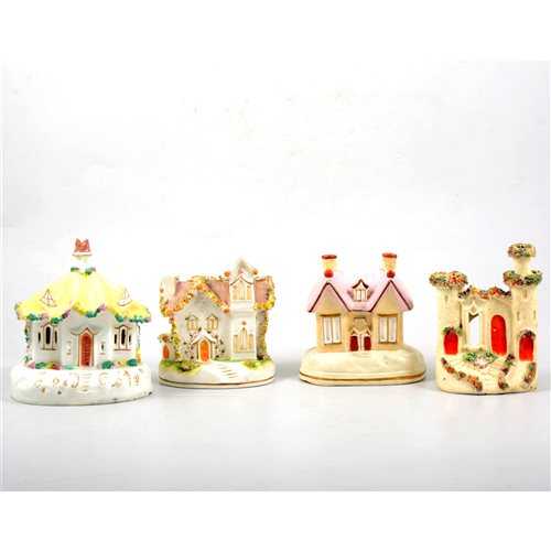 Lot 49-A collection of twenty five Staffordshire pottery cottages and pastille burners.
