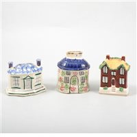 Lot 5-Three Pratt type pottery cottage money boxes.