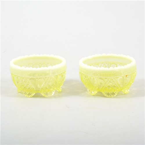 Lot 76-A pair of Victorian Vaseline/ Uranium glass open salt cellars.