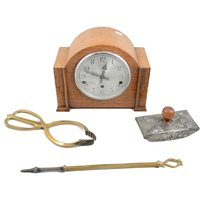 Lot 103-Three ink blotters, glove stretchers, an oak cased Enfield mantel clock and fireside set.
