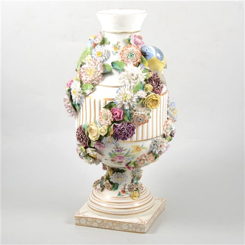 Lot 38 - German porcelain urn shape vase, encrusted floral decoration and modelled with birds, (restored)