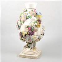 Lot 38-German porcelain urn shape vase, encrusted floral decoration and modelled with birds, (restored)