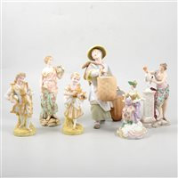 Lot 39-Pair of French bisque figurines of a young couple, and seven other Continental figures (9).