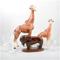 Lot 48-Two Melba ware pottery models of Giraffes, a pottery buffalo, a Waterford Crystal eagle, and a similar model of a rearing horse.
