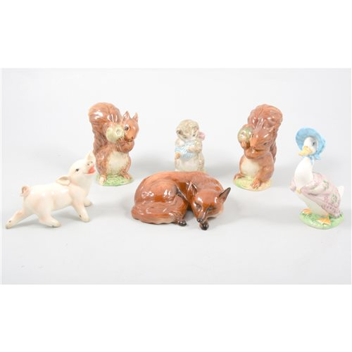 Lot 54-Collection of twelve Beswick Beatrix Potter models, two Beswick animals, and a Goebel pig.