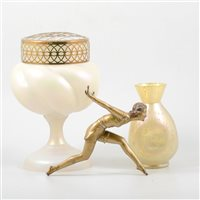 Lot 60-Loetz type glass vase, an opalescent vase and a patinated spelter Art Deco figure, (3),.