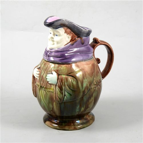 Lot 7-French Majolica style jug, modelled as a rotund toby, 22cm.