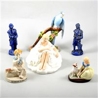 Lot 29-Thirteen assorted ceramic figures and ornaments including Royal Doulton, Hummel and Crown Staffordshire.