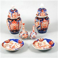 Lot 80-Pair of Imari covered vases, two small Imari bottle vases, three bowls, plates and dishes.