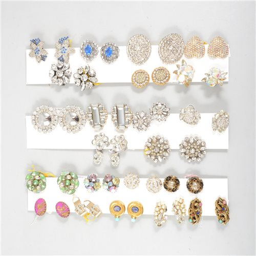 Forty pairs of vintage clip on costume jewellery earrings, coloured and...