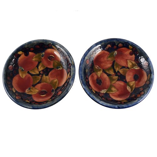 Lot 28-A pair of William Moorcroft plates, 'Pomegranate' design, circa 1920