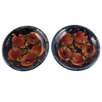 Lot 28-A pair of William Moorcroft plates, 'Pomegranate' design, circa 1920