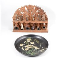 Lot 89-Carved beech pipe rack, 32cm, paper mache pipe rack, clay pipes, other pipes, etc.
