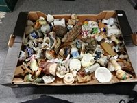 Lot 45-Two boxes of porcelain and ceramic figures, including Wade Whimsies, Mudlen End cottages, Beswick and others.