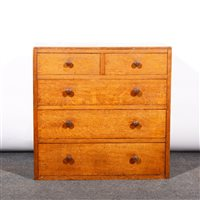Lot 505-An English Arts & Crafts style oak chest of drawers