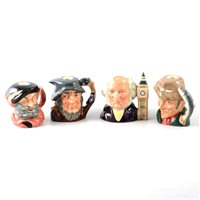 Lot 42-A collection of Royal Doulton figurines and character jugs.