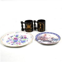 Lot 47-Two sets of four limited edition plates and four Portmeirion mugs