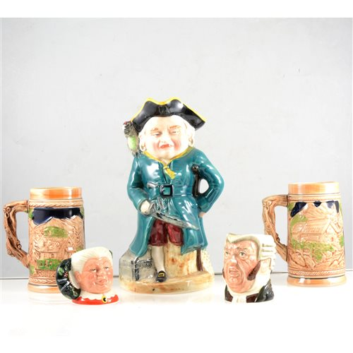 Lot 25-A collection of Toby jugs and beer steins.