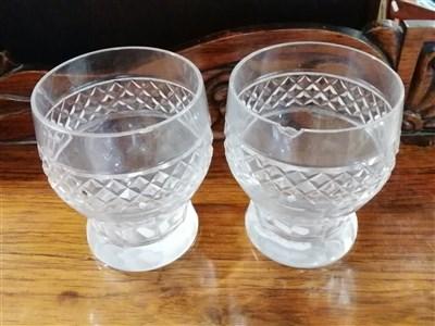 Lot 65-Near pair of Regency style cut-glass mallet-shape decanters, ...
