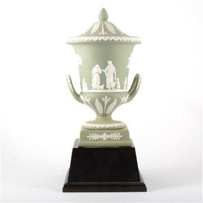 Lot 27-A green Jasperware campagna vase and cover, by Wedgwood.