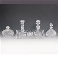 Lot 15-Moulded clear glass 8-piece dressing table set.