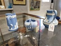 Lot 30-Three Wedgwood blue Jasperware jugs