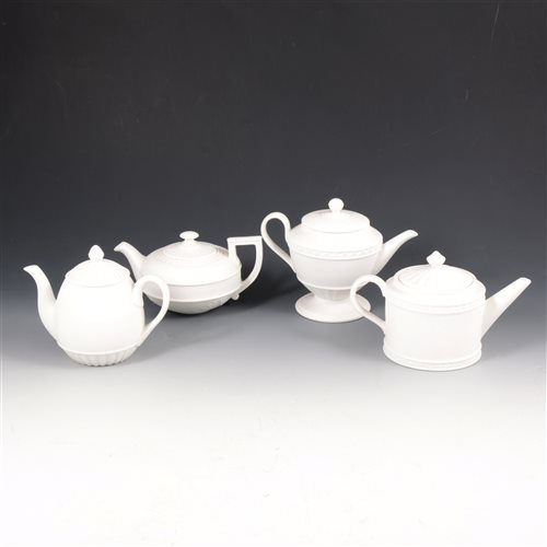Lot 34-Four Wedgwood white jasper teapot form candleholders.