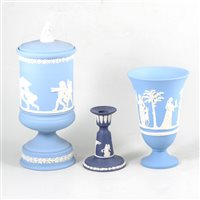 Lot 57-Wedgwood blue jasperware pedestal covered vase, 30cm, a flared vase, small circular bowl and a candlestick, (4).