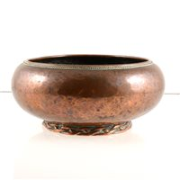 Lot 520-An Arts and Crafts copper bowl by Dryad Metal Works, Leicester